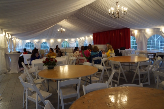 Tent with Round Tables and Chairs